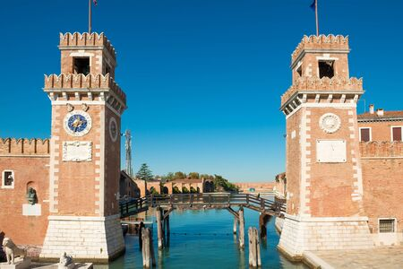 Entrance to Venetian Arsenal with clock and towers. Venice, Italy Stockfoto