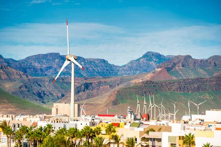 Wind turbines in small town near mountains at Canary islands, Spain