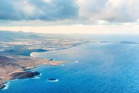 Airplane aerial view of coastal landscape and town o�° Arinaga on Gran Canaria island with ocean, hills and cities Stockfoto