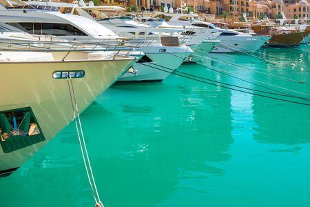 Luxury whute yachts moored at Porto Arabia marina. Pearl-Qatar, Doha, Qatar Stock Photo