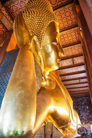 View to large golden statue of Reclining Buddha in temple Wat Pho. Bangkok, Thailand Reklamní fotografie