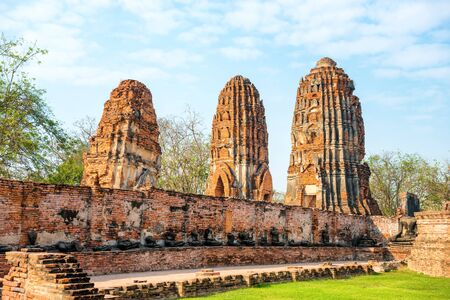 Historical and religious architecture of Thailand - ruins of old Siam capital Ayutthaya. View to brick remains of Wat Mahathat temple