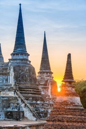 White chedies of buddhist temple Wat Phra Si Sanphet at sunset time. Architecture of Ayutthaya historical park, Thailand