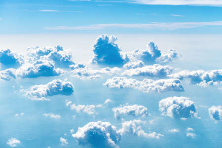 Blue sky with white clouds, above aerial view from a plane, nature blue sky background