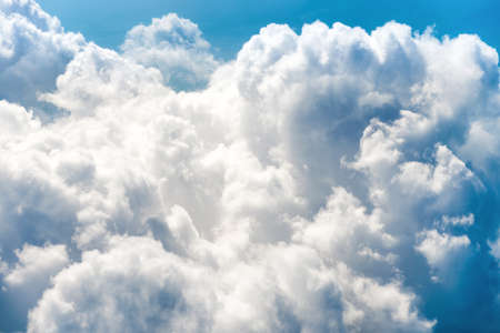 White clouds on blue sky with above aerial view from a plane, nature blue sky background
