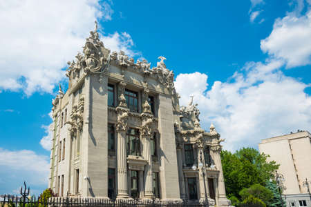 Famous House with Chimaeras - beautiful Art Nouveau building with animal figures decoration at sunny day at blue sky background. Kiev, Ukraine