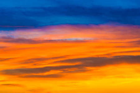 Sunset dramatic sky with colorful clouds as nature sunset background Imagens