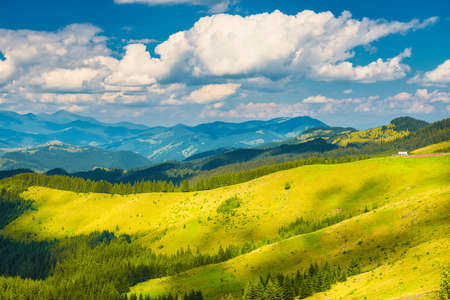 Green sunny valley in mountains and hills. Nature landscape Archivio Fotografico