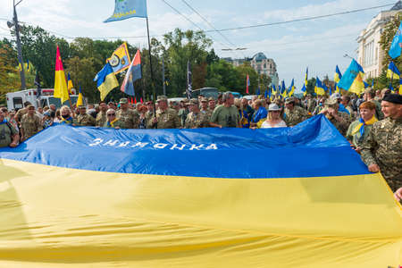 KIEV, UKRAINE - AUGUST 24, 2020: March of defenders, parade in Kyiv with Ukrainian flag, dedicated to the Independence Day of Ukraine, 29th anniversary.