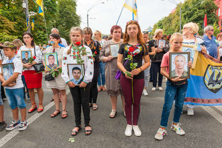 KIEV, UKRAINE - AUGUST 24, 2020: People with portraits of their killed in war relatives on March of defenders, parade in Kyiv, dedicated to the Independence Day of Ukraine, 29th anniversary.
