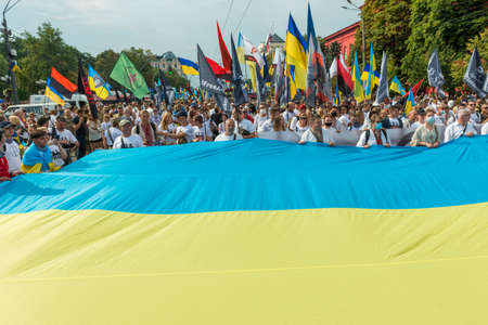 KIEV, UKRAINE - AUGUST 24, 2020: People with Ukrainian flag on March of defenders, parade in Kyiv, dedicated to the Independence Day of Ukraine, 29th anniversary.