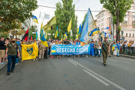 KIEV, UKRAINE - AUGUST 24, 2020: People with flags on March of defenders, parade in Kyiv, dedicated to the Independence Day of Ukraine, 29th anniversary. 에디토리얼