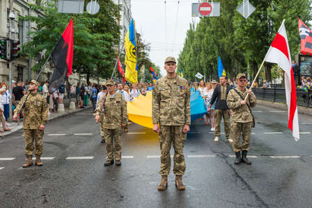 KIEV, UKRAINE - AUGUST 24, 2020: Soldiers and veterans with Ukrainian and Belarus flags on March of defenders, parade in Kyiv, Ukraine.