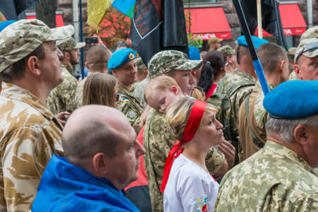 KIEV, UKRAINE - AUGUST 24, 2020: Sleeping child on March of defenders, parade in Kyiv, dedicated to the Independence Day of Ukraine, 29th anniversary. 에디토리얼