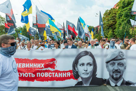 KIEV, UKRAINE - AUGUST 24, 2020: People with banner on March of defenders, parade in Kyiv, dedicated to the Independence Day of Ukraine, 29th anniversary. 에디토리얼