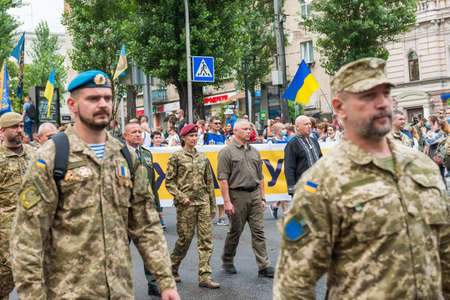 KIEV, UKRAINE - AUGUST 24, 2020: Oleksands Turchinov, Mykhailo Zabrodskyi and Marusya Zverobiy, soldiers and veterans on March of defenders, parade in Kyiv, dedicated to the Independence Day of Ukraine, 29th anniversary.