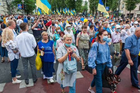 KIEV, UKRAINE - AUGUST 24, 2020: People with Ukrainian flags on March of defenders, parade in Kyiv, dedicated to the Independence Day of Ukraine, 29th anniversary.
