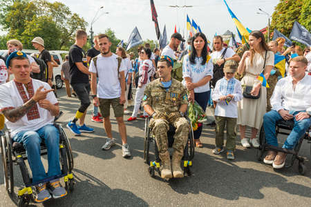 KIEV, UKRAINE - AUGUST 24, 2020: Disabled soldiers in wheelchairs on march of defenders, parade in Kyiv, dedicated to the Independence Day of Ukraine, 29th anniversary.