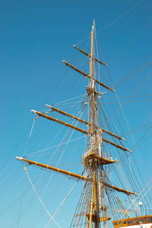 Beautiful sailing vessel with big masts on the mooring 스톡 콘텐츠