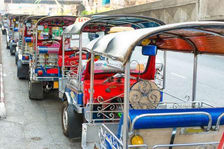 Many asian taxi tuk tuk in Bangkok street