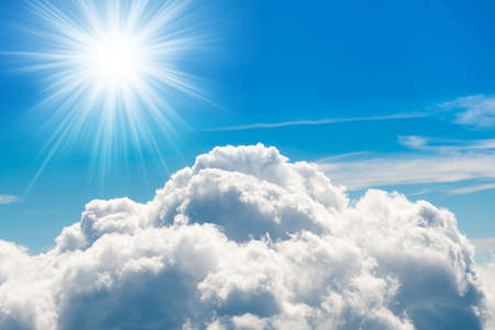White clouds on blue sky with sun above aerial view from a plane, nature blue sky background