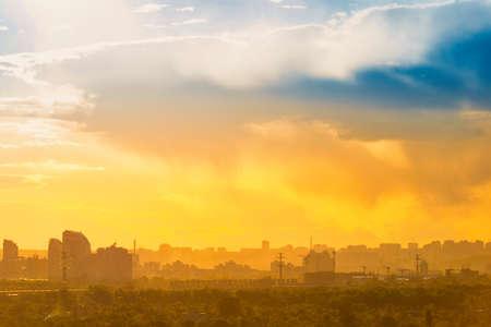Sunset in big city, downtown cityscape with sunset sky Reklamní fotografie