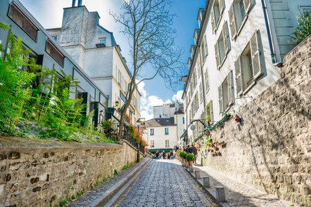 Cozy tourist alley in Paris, Monmartre street, France