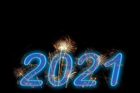 2021 new year blue fireworks on black sky background. Holiday celebration. Reklamní fotografie