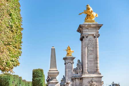 Golden statues on Alexandre III bridge near Les Invalides in Paris, France