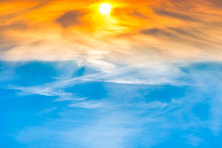 Sunset sun on orange and blue sunset sky