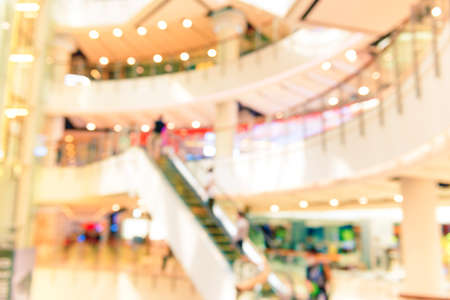 Blurred interior of mall retail business store with blur people