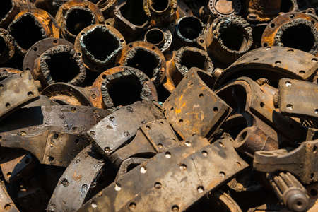 Pile of old rusty metal scrap, used machine spares and car parts can be used as mechanic industrial background