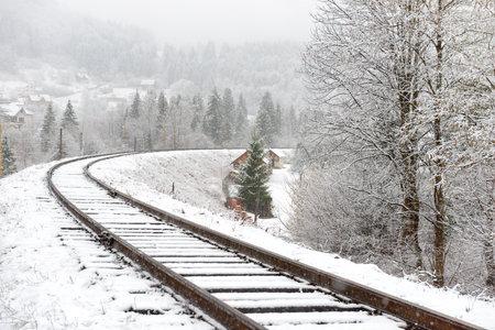 Railway in snow. Winter landscape with empty rail tracks