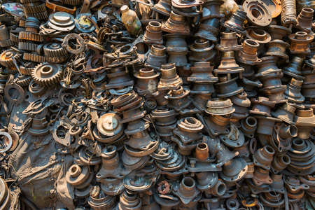 Old rusty metal scrap, used machine spares and car parts can be used as mechanic industrial background