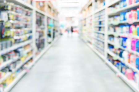 Market shop and supermarket interior with customers as blurred store background