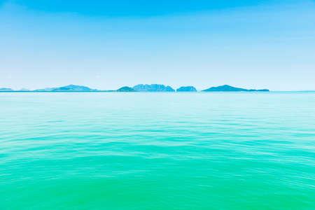 Island in blue sea, calm sea landscape with blue water