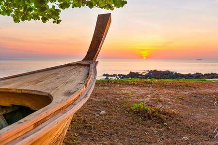 Wooden boat on sunset beach. Boat sunset beach landscape
