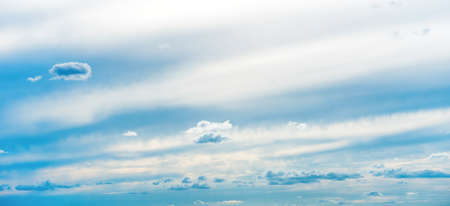 Panorama of blue sunset sky background with white clouds Banque d'images