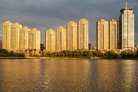 architecture alphabet: Evening light on buildings above the Nanhu Lake, Wulumuqi, Xinjiang, China.