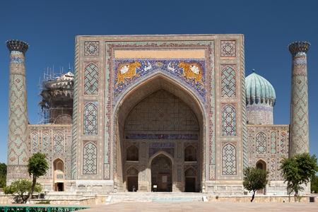 registan: Front view of SherDor Madrasa from Registan Square Samarkand Uzbekistan.