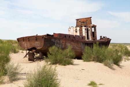 lost lake: Abadoned ship in Aral Desert Munyak Republic of Karakalpakstan Uzbekistan.