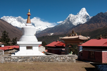 View of stupa at Tengboche Monastery with Mt. Everest Nuptse to Lhotse ridge and Ama Dablam in the background Tengboche Solu Khumbu Nepal. photo