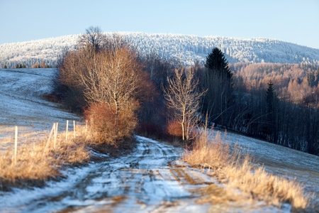 sudetes: Early Spring landscape with road in a snowymeadows Eastern Sudetes Czech Republic.