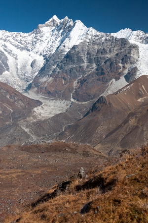 ganja: View of Langtang Valley with Mt. Kimshung and Langtang Lirung Glacier in the background from trekking route to Ganja La, Langtang National Park, Rasuwa District, Bagmati, Nepal. Stock Photo