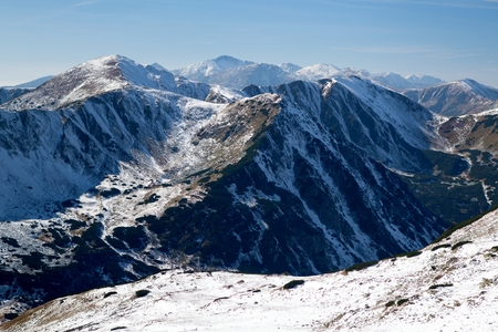 ridges: View of snowy ridges of the Western Tatras Western Tatras mountains and Liptovske kicks from a smooth saddle Smooth Pass, Red Hill Red Mountains, Western Carpathians, Slovakia.