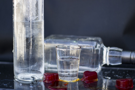 vodka bottle: Vodka bottle with glasses and a red ice, vodka and whiskey in glass with ice, alcoholic drink