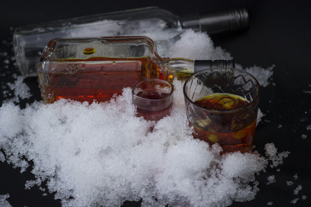 alcoholic drink: Cool alcoholic drink, Vodka with ice close-up on a black background,close-up on a black background Stock Photo