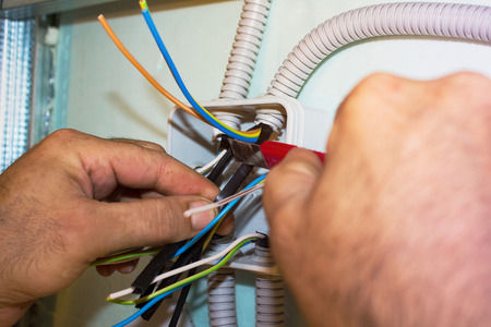 Electricians clears wire for electricity installation