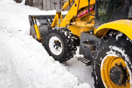 Tractor to clean the snow on the street