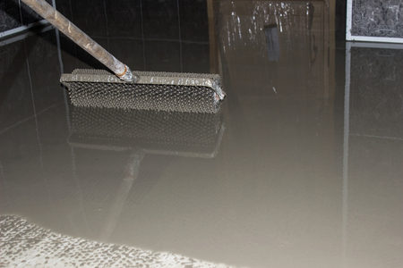 cement floor: Floor leveling. Filling the floor with a self-leveling compound